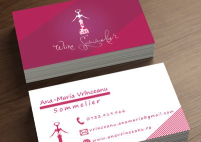 Wine sommelier business card that shows a wine bottle being opened.