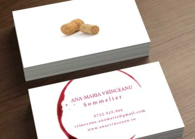 Wine sommelier business card that shows a bottle stopper on the back.